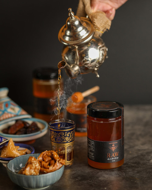 pouring Moroccan tea with raw lavender honey